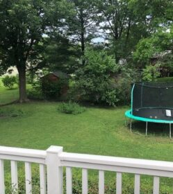 Back fenced yard from deck